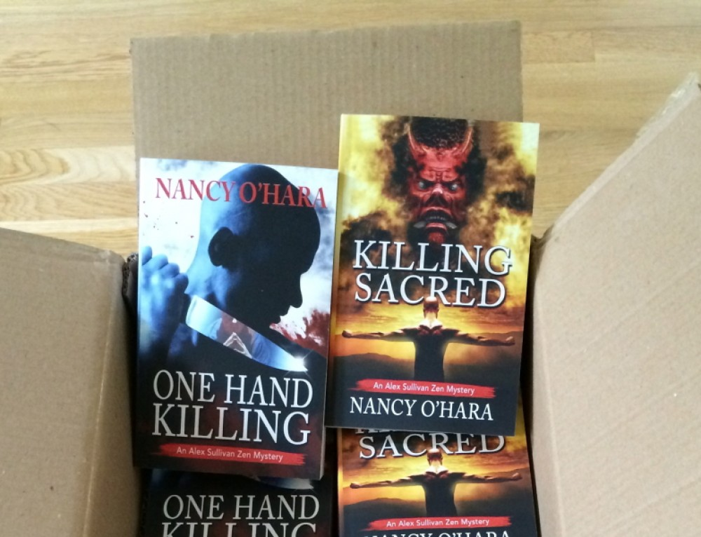 Win a Free Edition of One Hand Killing or Killing Sacred!